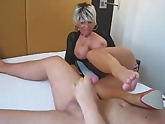 Milf gives handjob with the..