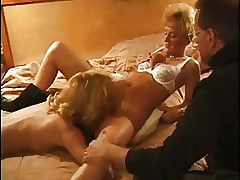 Grown-up swinger couple with..