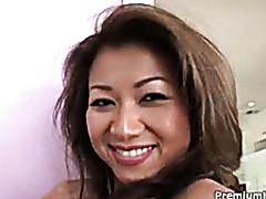 Cute Asian milf is having..